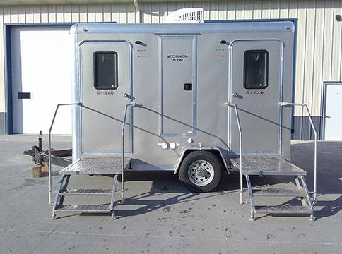 Moen's sleek portable silver VIP 4 stall restroom trailer